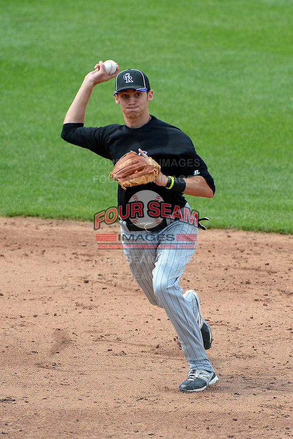 Third baseman Dylan Busby (2) of Sarasota High School in Sarasota, Florida playing for the Colorado Rockies scout team during the East Coast Pro Showcase on July 31, 2013 at NBT Bank Stadium in Syracuse, New York.  (Mike Janes/Four Seam Images)