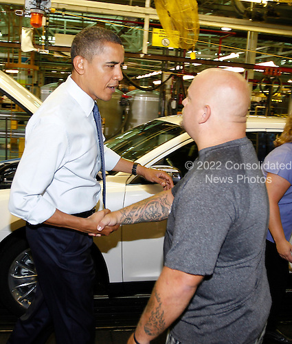 United States President Barack Obama greets an assembly line worker as he tours the Chicago Ford Motor Company Plant, Thursday,  August 5, 2010.  .Credit: Jeff Haynes - Pool via CNP