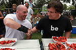 Stover Harger shakes the hand of three-time crawfish eating champion.... before this year's contest begins.