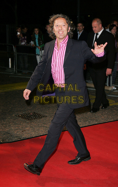 """IAN REDDINGTON.Celebrity Guests attend """"Another Audience with Al Murray - Pub Landlord"""" at London ITV Studios, South Bank, London, England, October 21st 2007..full length pink striped shirt black suit hand waving.CAP/ROS.©Steve Ross/Capital Pictures"""