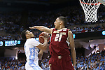 18 January 2014: Boston College's Olivier Hanlan (21) tries to block a shot by North Carolina's Nate Britt (left). The University of North Carolina Tar Heels played the Boston College Eagles in an NCAA Division I Men's basketball game at the Dean E. Smith Center in Chapel Hill, North Carolina. UNC won the game 82-71.