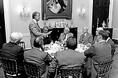 "United States President Jimmy Carter addresses members of the Democratic Congressional Leadership breakfast in the first floor Private Dining Room of the White House in Washington, DC on January 25, 1977.  Visible from left to right: Speaker of the US House of Representatives Thomas P. ""Tip"" O'Neill (Democrat of Massachusetts), the President, US Senate Majority Leader Robert Byrd (Democrat of West Virginia), President pro tempore of the US Senate James O. Eastland (Democrat of Mississippi), First Deputy President pro tempore of the US Senate Hubert H. Humphrey, Jr. (Democrat of Minnesota), and US Senate Majority Whip Alan M. Cranston (Democrat of California).<br /> Credit: White House via CNP"