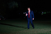 United States President Donald J. Trump waves to the media as he returns to the White House in Washington, DC after attending a political event in Fayetteville, North Carolina on Saturday, September 19, 2020. <br /> Credit: Chris Kleponis / Pool via CNP