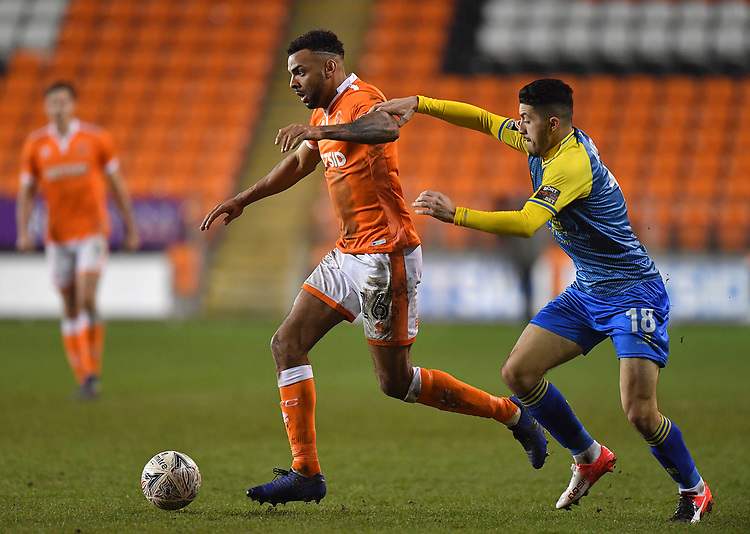 Blackpool's Curtis Tilt battles with Solihull Moors' Jordan Murphy<br /> <br /> Photographer Dave Howarth/CameraSport<br /> <br /> The Emirates FA Cup Second Round Replay - Blackpool v Solihull Moors - Tuesday 18th December 2018 - Bloomfield Road - Blackpool<br />  <br /> World Copyright © 2018 CameraSport. All rights reserved. 43 Linden Ave. Countesthorpe. Leicester. England. LE8 5PG - Tel: +44 (0) 116 277 4147 - admin@camerasport.com - www.camerasport.com