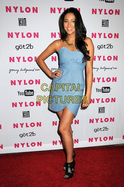 SHAY MITCHELL.Nylon Magazine's Young Hollywood Party held at the Roosevelt Hotel's Tropicana Bar, Hollywood, California, USA..May 12th, 2010.full length dress hand on hip black ankle boots open toe blue strapless .CAP/ADM/BP.©Byron Purvis/AdMedia/Capital Pictures.