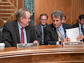 United States Senators Mike Crapo (Republican of Idaho), left, Chairman, US Senate Committee on Banking, Housing and Urban Affairs, left, and Sherrod Brown (Democrat of Ohio), right, Ranking Member, converse prior to hearing testimony from Kathleen Laura Kraninger, on her nomination to be Director, Bureau of Consumer Financial Protection (CFPB), and Kimberly A. Reed on her nomination to be President, Export-Import Bank, before the  on Capitol Hill in Washington, DC on Thursday, July 19, 2018.<br /> Credit: Ron Sachs / CNP