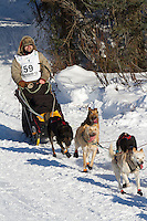 Musher Cim Smyth on Long Lake at the Re-Start of the 2011 Iditarod Sled Dog Race in Willow, Alaska.