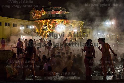 Revellers dance in the thermal water during the Night of Baths in Budapest, Hungary on March 11, 2012. ATTILA VOLGYI
