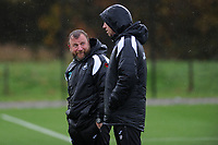 Billy Reid, assistant manager for Swansea speaks to Graham Potter Manager of Swansea City during the Swansea City Training at The Fairwood Training Ground, Swansea, Wales, UK. Wednesday 07 November 2018