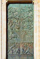 Close up of the main door sculptures made in 1970 by the Sicilian sculptor Emilio Greco (1913–1995) depicting mercies from the life of Christ, 14th century Gothic facade of the Cathedral of Orvieto, Umbria, Italy