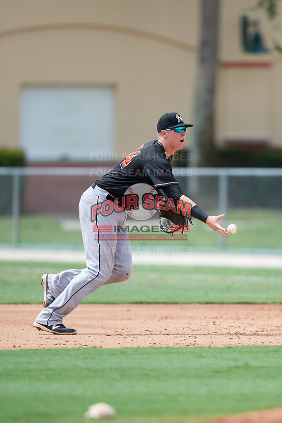 GCL Marlins first baseman Sean Reynolds (34) flips the ball to the pitcher covering first base during a game against the GCL Astros on July 22, 2017 at Roger Dean Stadium Complex in Jupiter, Florida.  GCL Astros defeated the GCL Marlins 5-1, the game was called in the seventh inning due to rain.  (Mike Janes/Four Seam Images)