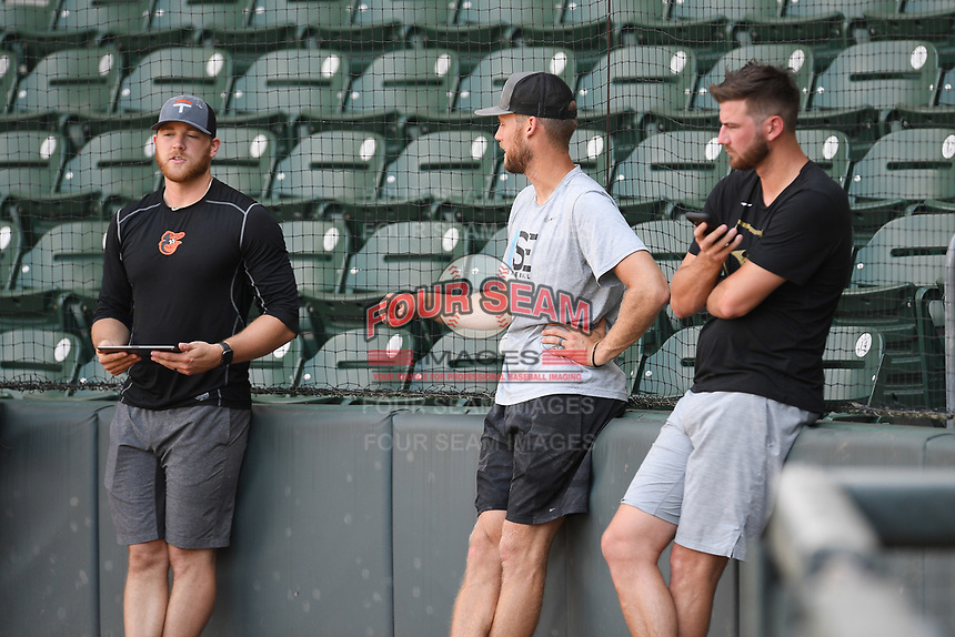 David Hess of the Baltimore Orioles, left, former Boston Red Sox pitcher Daniel Bard, center, and Chad Sobotka of the Atlanta Braves wait their turns to pitch at a workout during the coronavirus shutdown with local Major League and Minor League players from around the Upstate on Tuesday, June 2, 2020, at Fluor Field at the West End in Greenville, South Carolina. (Tom Priddy/Four Seam Images)