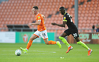 Blackpool's Jordan Thompson under pressure from Macclesfield Town's Emmanuel Osadebe<br /> <br /> Photographer Kevin Barnes/CameraSport<br /> <br /> The Carabao Cup First Round - Blackpool v Macclesfield Town - Tuesday 13th August 2019 - Bloomfield Road - Blackpool<br />  <br /> World Copyright © 2019 CameraSport. All rights reserved. 43 Linden Ave. Countesthorpe. Leicester. England. LE8 5PG - Tel: +44 (0) 116 277 4147 - admin@camerasport.com - www.camerasport.com