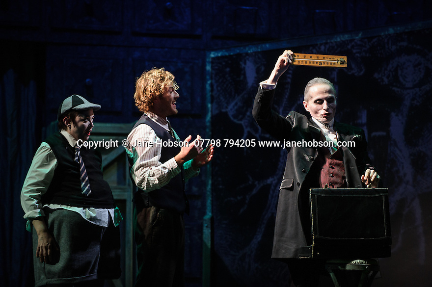 London, UK. 07.10.2015. English Touring Opera presents THE TALES OF HOFFMANN, at the Britten Theatre, Royal College of Music. Written by Jacques Offenbach, with libretto by Jules Barbier, this production is directed by James Bonas. Picture shows: Louise Mott (Nicklausse), Sam Furness (Hoffmann), Warwick Fyle (Dr Miracle).  Photograph © Jane Hobson.