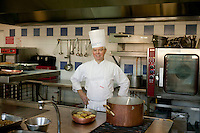 An unidentified chef poses in his kitchen at the Ecole Superieure de Cuisine Francaise Gregoire Ferrandi cooking school in Paris, France, 18 December 2007.