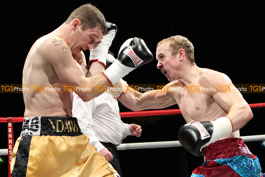 Lenny Daws (yelow shorts) beats Chris Truman on points in a Boxing contest at the Magna Centre, Rotherham, promoted by Hennessy Sports - 18/02/12 - MANDATORY CREDIT: Chris Royle/TGSPHOTO - Self billing applies where appropriate - 0845 094 6026 - contact@tgsphoto.co.uk - NO UNPAID USE..
