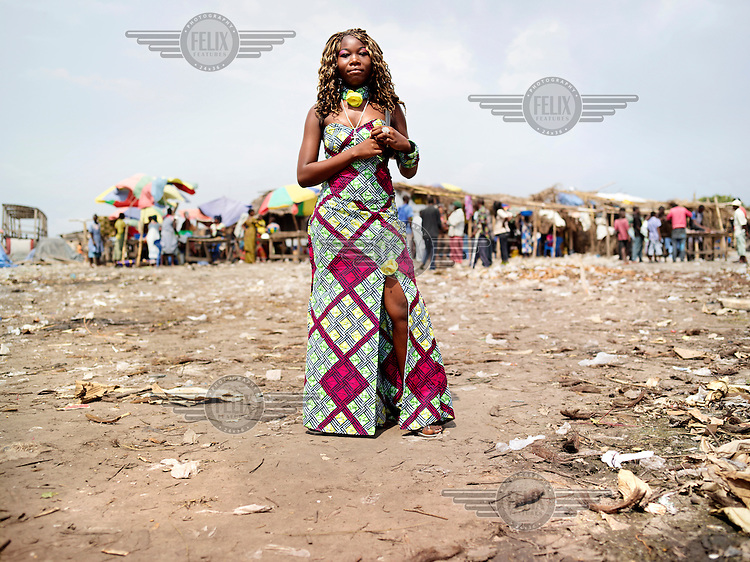 A young women poses for a portrait in the small fishing village of Maluka.