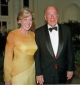 Former United States Secretary of State George P. Shultz and his wife, Charlotte Mailliard Shultz, arrive at The White House for the State Dinner honoring President Jiang Zemin of China.<br /> Credit: Ron Sachs / CNP