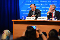 Washington, DC - April 14, 2016: Jim Yong Kim, President of the World Bank Group, speaks to members of the media during a press availability at the IMF headquarters in the District of Columbia, April 14, 2016, as communications advisor John Donnelly (r) ooks on.  (Photo by Don Baxter/Media Images International)