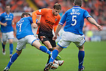 Dundee United v St Johnstone...24.08.13      SPFL<br /> David Goodwillie tries to get between Chris Millar and Frazer Wright<br /> Picture by Graeme Hart.<br /> Copyright Perthshire Picture Agency<br /> Tel: 01738 623350  Mobile: 07990 594431