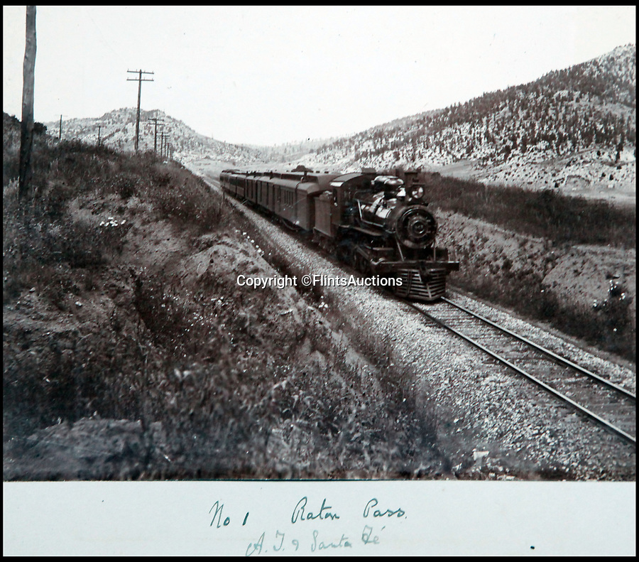 BNPS.co.uk (01202 558833)<br /> Pic: FlintsAuctions/BNPS<br /> <br /> No 1 locomotive in the Raton Pass on the Santa Fe railroad.<br /> <br /> Unseen album reveals the life of a cowboy in the real wild west...<br /> <br /> Fascinating previously unseen early photos of cowboys in the Wild West have come to light 130 years later.<br /> <br /> They show life on the ranches of Colorado and New Mexico in the vast expanses of the south west US in the 1880s.<br /> <br /> One dramatic image captures the thrilling moment a group of cowboys ride towards the camera with hats held aloft.<br /> <br /> The photos are thought to have been taken by a British farmhand who travelled Stateside in the late 19th century to earn a living.