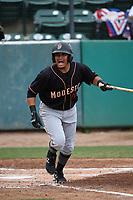 Eugene Helder (10) of the Modesto Nuts bats against the Visalia Rawhide at Recreation Ballpark on June 10, 2019 in Visalia, California. (Larry Goren/Four Seam Images)