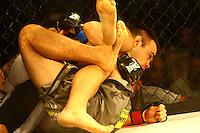 OSASCO, SP, 29.03.2014 - CIRCUITO TALENT MMA - Circuito de MMA Talent em Osasco, zona oeste de São Paulo realizado no ginásio de esportes Geodésico, reúne atletas do MMA nacional e internacional. <br /> Na foto:  Celsinho Venicius - vencedor(shorts branco e preto) e André Urso -  (shorts cinza) <br /> Destaque para o duelo entre Marcos Babuíno e João Paulo Rodrigues, pelo cinturão dos penas. <br /> (Foto: Aloisio Mauricio / Brazil Photo Press).