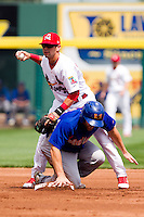 Jose Garcia (3) of the Springfield Cardinals tries to turn a double play but is hit by a Midland RockHounds base runner during a game against the Midland RockHounds on April 19, 2011 at Hammons Field in Springfield, Missouri.  Photo By David Welker/Four Seam Images