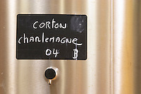 A stainless steel fermentation vat with a black chalk board with text in chalk Corton Charlemagne Grand Cru 2004, Maison Louis Jadot, Beaune Côte Cote d Or Bourgogne Burgundy Burgundian France French Europe European