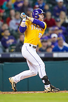 LSU Tigers outfielder Jake Fraley (23) follows through on his swing during the Houston College Classic against the Nebraska Cornhuskers on March 8, 2015 at Minute Maid Park in Houston, Texas. LSU defeated Nebraska 4-2. (Andrew Woolley/Four Seam Images)