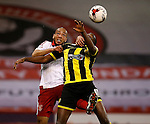 Alex Baptiste of Sheffield Utd tackles Lucas Akins of Burton Albion - English League One - Sheffield Utd vs Burton Albion - Bramall Lane Stadium - Sheffield - England - 1st March 2016 - Pic Simon Bellis/Sportimage