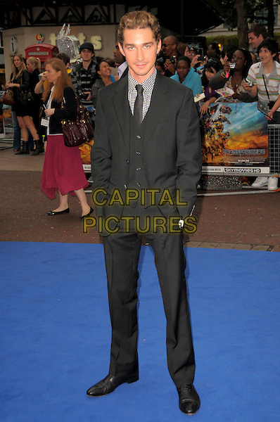 SHIA LaBEOUF.'Transformers: Revenge of the Fallen' .UK film premiere at Odeon cinema, Leicester Square, London, England..15th June 2009.full length black suit hands in pockets LaBoeuf La Boeuf waistcoat .CAP/CAS.©Bob Cass/Capital Pictures.
