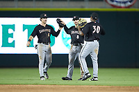 (L-R) Kannapolis Intimidators outfielders Romy Gonzalez (6), Ian Dawkins (8), and Bryce Bush (30) celebrate their win over the Augusta GreenJackets at SRG Park on July 6, 2019 in North Augusta, South Carolina. The Intimidators defeated the GreenJackets 9-5. (Brian Westerholt/Four Seam Images)