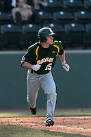 Adam Toth #15 of the Baylor Bears runs to first base against the UCLA Bruins at Jackie Robinson Stadium on February 25, 2012 in Los Angeles,California. UCLA defeated Baylor 9-3.(Larry Goren/Four Seam Images)