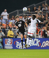 DC United defender Devon McTavish (18) goes up to head the ball against New England Revolution forward Kheli Dube (11), DC United defeated the New England Revolution 2-1, at RFK Stadium in Washington DC, Thursday October 16, 2008. Photo by Jose Argueta/isiphotos.com
