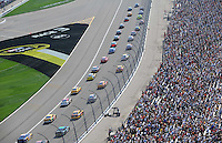 Sept. 28, 2008; Kansas City, KS, USA; Nascar Sprint Cup Series drivers go by the main grandstands prior to the start of the Camping World RV 400 at Kansas Speedway. Mandatory Credit: Mark J. Rebilas-