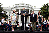 United States President Donald J. Trump speaks as First Lady Melania Trump (L), Vice President Mike Pence and Karen Pence (R) look on during the Congressional Picnic in the South Lawn  of the White House in Washington, DC, on June 22, 2017. <br /> Credit: Olivier Douliery - Pool via CNP /MediaPunch