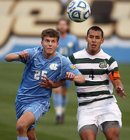 North Carolin'a Rob Lovejoy (25) and Charlotte's Charles Rodriguez (4) battle for the ball during the NCAA 2011 Men's College Cup in Hoover, AL on Sunday, December 11, 2011.