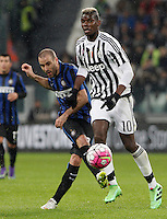 Calcio, Serie A: Juventus vs Inter. Torino, Juventus Stadium, 28 February 2016.<br /> Inter's Rodrigo Palacio, left, is challenged by Juventus&rsquo; Paul Pogba during the Italian Serie A football match between Juventus and Inter at Turin's Juventus Stadium, 28 February 2016.<br /> UPDATE IMAGES PRESS/Isabella Bonotto