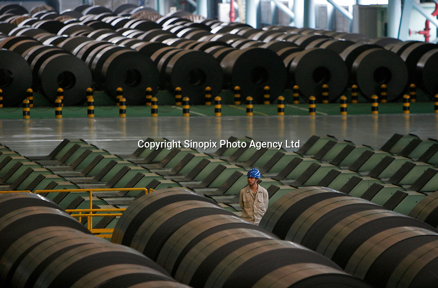 Workers at the Baosteel-NSC-Arcelor Automotive Sheet Co., LTD in Shanghai, China..