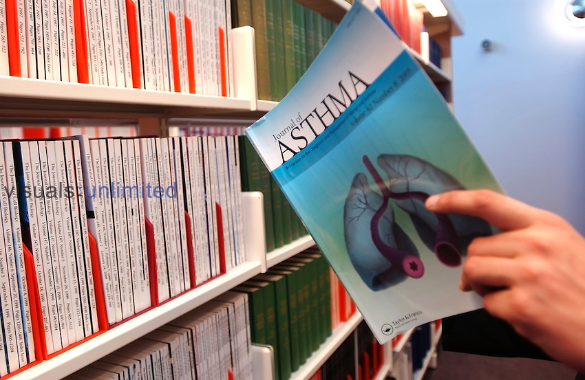 The search for a new asthma drug begins with research into the area, using medical journals such as the Journal of Asthma. Libraries with such journals are an essential resource for medicinal chemistry, the first stage in drug discovery and development. Royalty Free