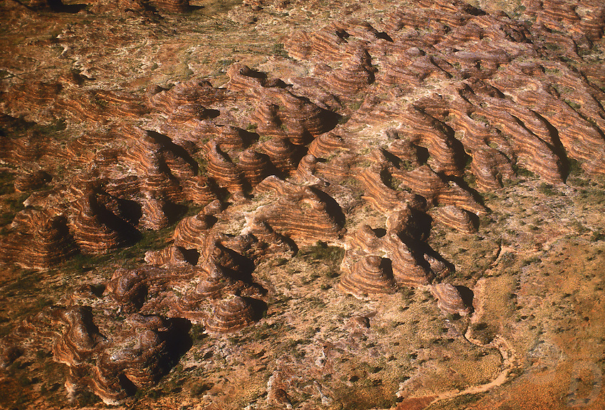 Aerial over the Bungle Bungle Western Australia PURNULULU NATIONAL PARK, WA. Purnululu National Park in Western Australia comprises the Bungle Bungle Range; its distinctive beehive formation was shaped by 20 million years of erosion and uplift. The area has been used by Aboriginal people for thousands of years as a hunting ground during the wet season when plant and animal life is more abundant. As a result it is rich in Aboriginal artwork and burial sites, but few Europeans knew of its existence until the mid-1980s. The area was declared a national park in 1987, and a World Heritage Site in 2003 (for natural beauty) and again in 2005 (for cultural significance).