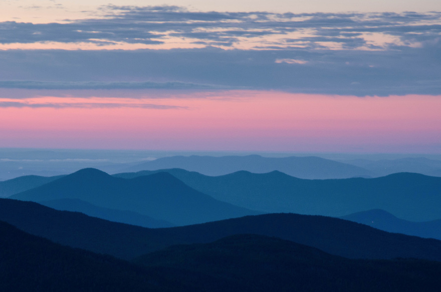 Mile upon mile of mountainous terrain awaits dawns first light from above treeline on the Crawford Path, New Hampshires White Mountains.