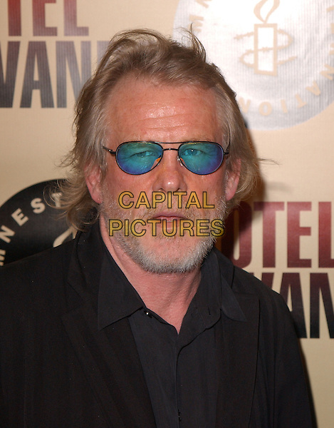 "NICK NOLTE.Los Angeles Premiere of ""Hotel Rwanda"" held at The Academy Theatre in Beverly Hills, California.December 2nd, 2004.headshot, portrait, beard, facial hair, , tinted glasses, sunglasses, shades.www.capitalpictures.com.sales@capitalpictures.com.Supplied by Capital Pictures."