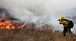 A brush fire burns through Pleasant Valley, south of Reno, Nev., on Thursday, Jan. 19, 2012. (AP Photo/Cathleen Allison)