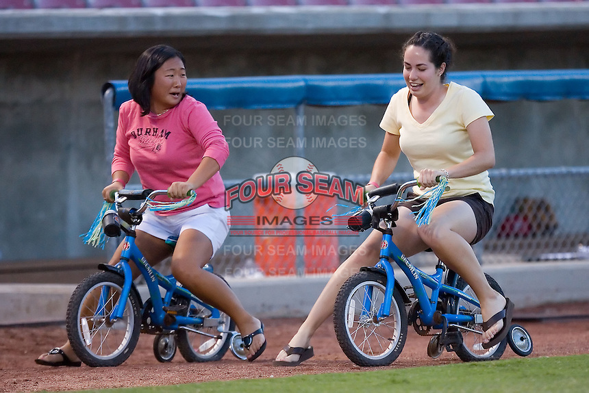 The adults on small bikes race at Ernie Shore Field in Winston-Salem, NC, Thursday July 27, 2008. (Photo by Brian Westerholt / Four Seam Images)