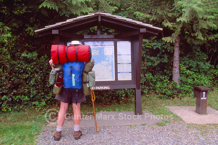 Cape Scott Provincial Park, Northern Vancouver Island, BC, British Columbia, Canada - Hiker reading Map and Sign at Start of Hiking Trail