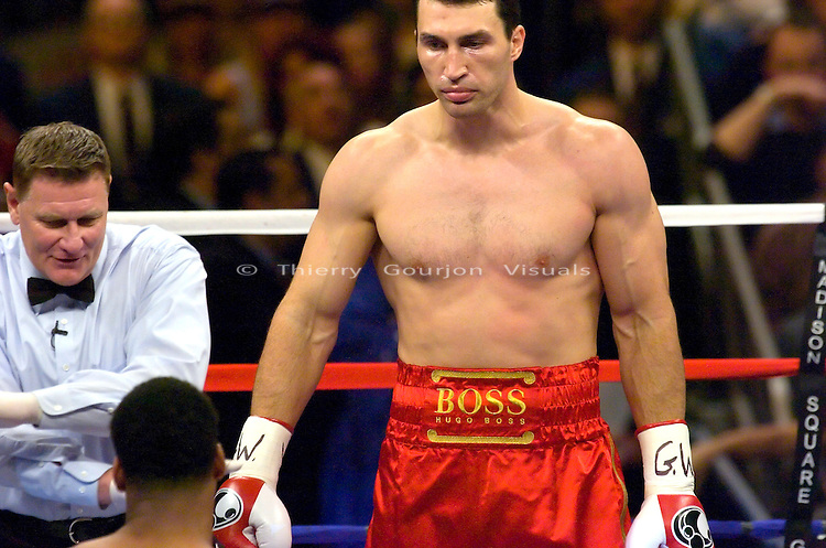 Wladimir Klitschko (r) watches Calvin Brock get up after a ruled slip during their  IBF/IBO Heavyweight Championship at Madison Square Garden  in NYC on 11.11.06..Klitschko won by a 7th  round KO.<br />