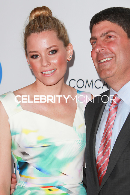 UNIVERSAL CITY, CA, USA - SEPTEMBER 30: Elizabeth Banks, Jeff Shell arrive at LA's Promise Gala 2014 held at the Globe Theatre at Universal Studios on September 30, 2014 in Universal City, California, United States. (Photo by David Acosta/Celebrity Monitor)