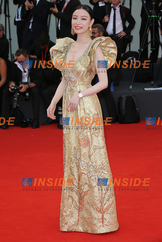 """VENICE, ITALY - AUGUST 28: Ni Ni walks the red carpet ahead of the Opening Ceremony and the """"La Verite"""" (The Truth) screening during the 76th Venice Film Festival at Sala Grande on August 28, 2019 in Venice, Italy., 2019 in Venice, Italy. (Photo by Marck Cape/Inside Foto)<br /> Venezia 28/08/2019"""